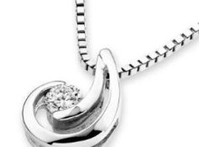 152239576_18k-white-gold-flush-setting-diamond-solitaire-crescent-
